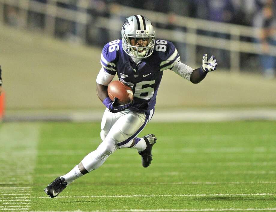 Kansas State PR Tramaine ThompsonPHOTO:  Thompson runs with the ball during a game against the Texas Longhorns on Dec. 1, 2012, at Bill Snyder Family Stadium in Manhattan, Kansas. Photo: Peter G. Aiken, Getty Images / 2012 Peter G. Aiken