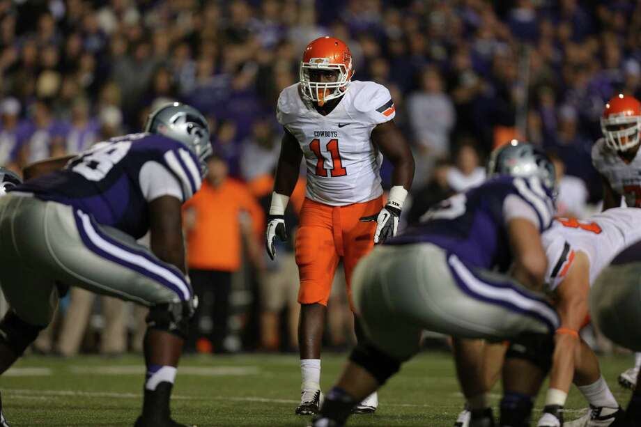 Oklahoma State LB Shaun LewisPHOTO: Lewis prepares to rush the line during a game against Kansas State at Bill Snyder Family Football Stadium on Nov. 3, 2012, in Manhattan, Kansas. Photo: Ed Zurga, Getty Images / 2012 Getty Images