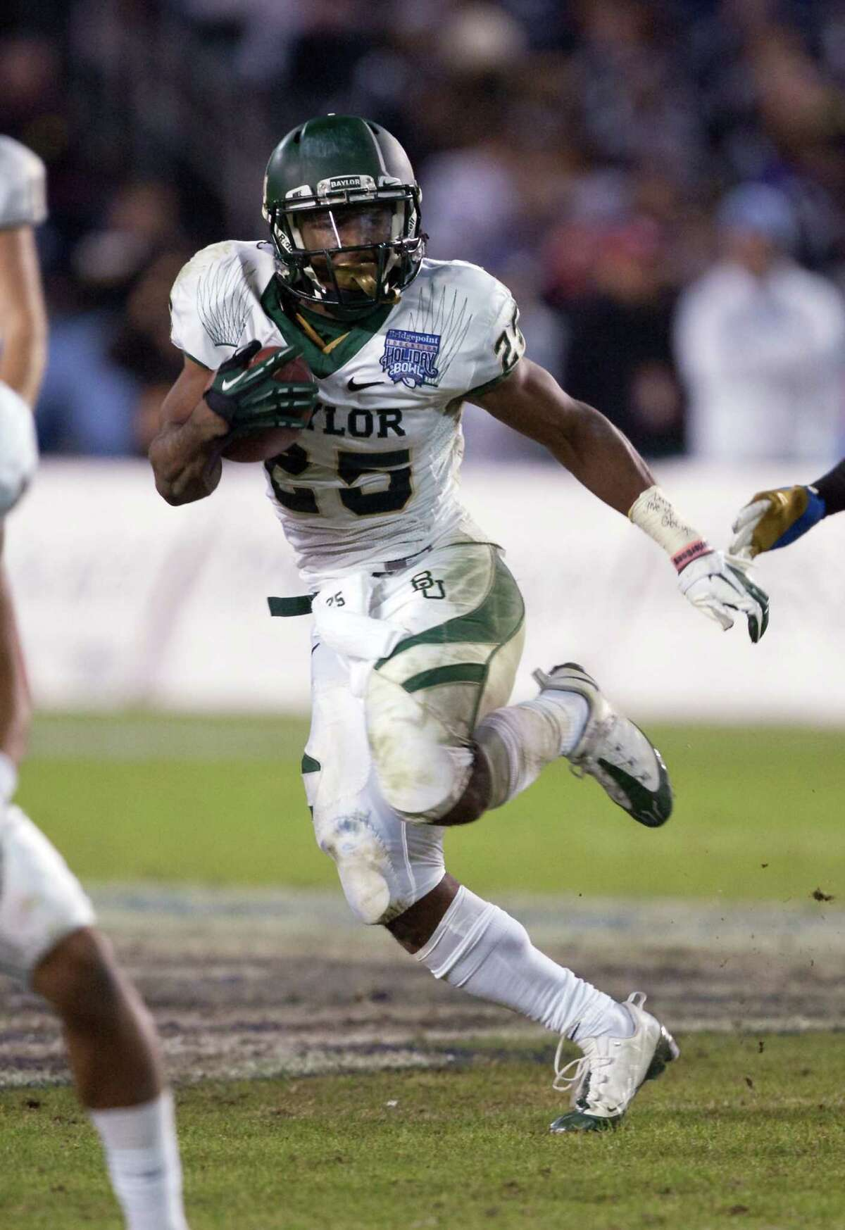 OFFENSIVE PLAYER OF THE YEAR: Baylor RB Lache SeastrunkPHOTO: Seastrunk runs with the ball against UCLA in the Bridgepoint Education Holiday Bowl at Qualcomm Stadium on Dec. 27, 2012, in San Diego, Calif.