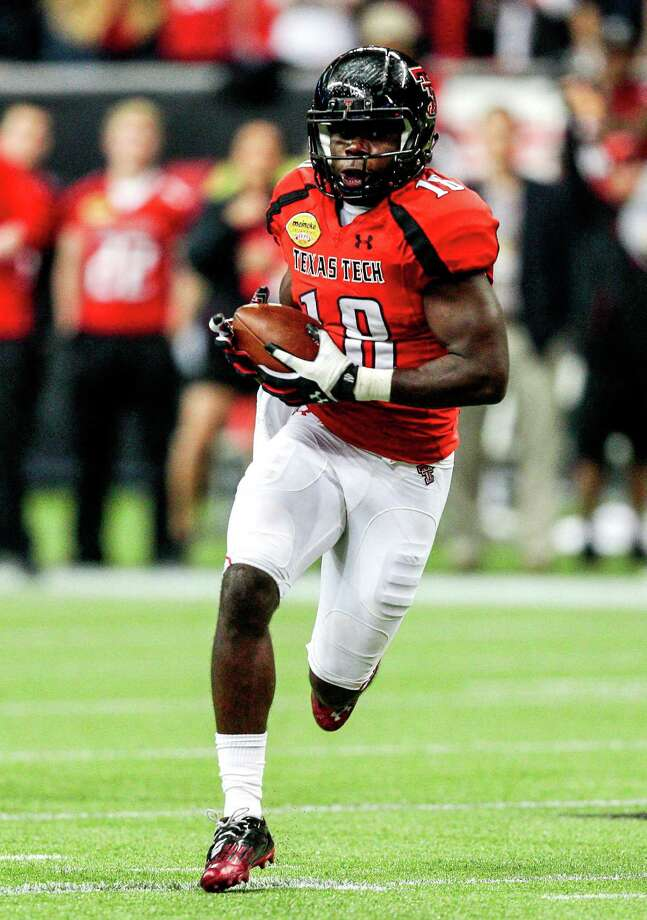 Texas Tech WR Eric WardPHOTO:  Ward breaks loose for a touchdown against Minnesota during the Meineke Car Care of Texas Bowl at Reliant Stadium on Dec. 28, 2012, in Houston. Photo: Bob Levey, Getty Images / 2012 Getty Images