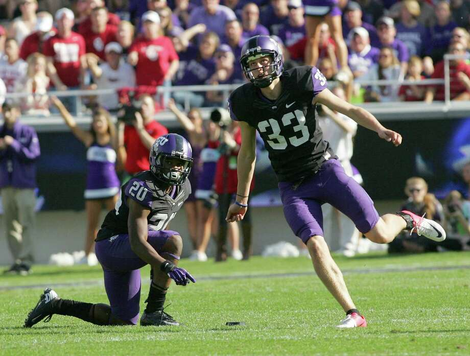 TCU PK Jaden OberkromPHOTO: TCU's Aaron Green holds the ball for Oberkrom against Oklahoma at Amon G. Carter Stadium on Dec. 1, 2012, in Fort Worth. Photo: R. Yeatts, Getty Images / 2012 Getty Images
