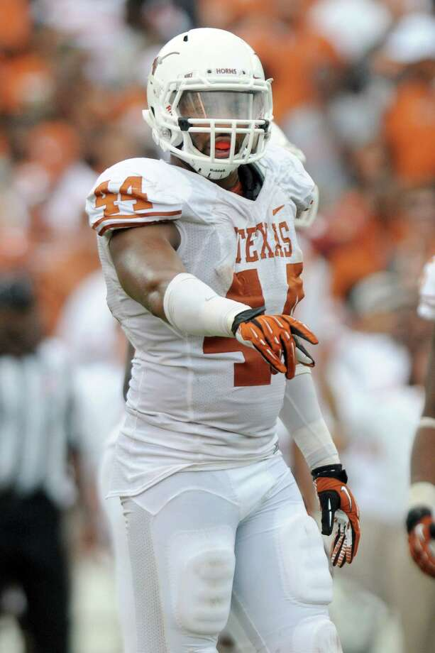 Texas DL Jackson JeffcoatPHOTO: Jeffcoat locates an assignment against Oklahoma on Oct. 13, 2012, at the Cotton Bowl in Dallas. Photo: Jackson Laizure, Getty Images / 2012 Jackson Laizure