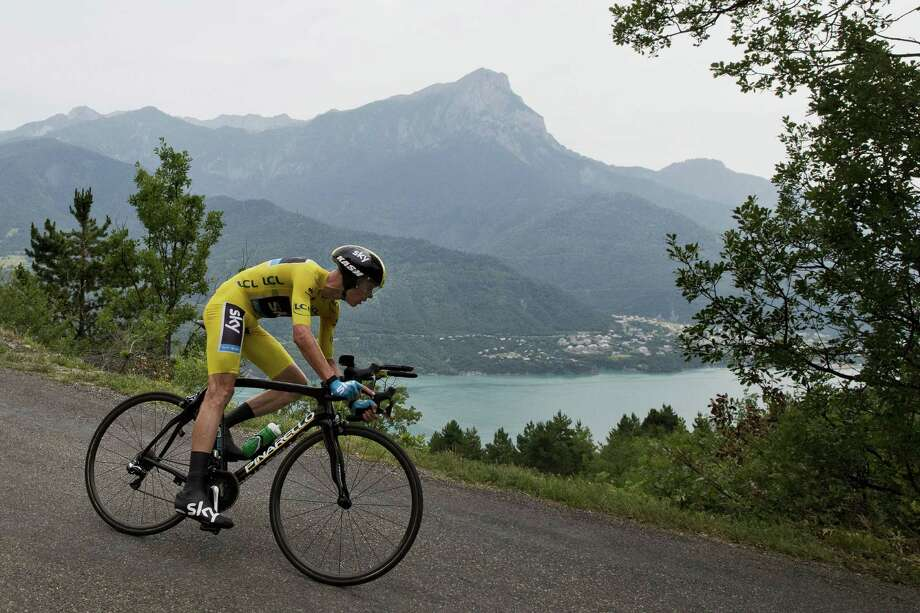 Chris Froome didn't get to take in the scenery Wednesday, but he did enjoy a stage win that makes his overall victory even more inevitable. Photo: JEFF PACHOUD, Staff / AFP