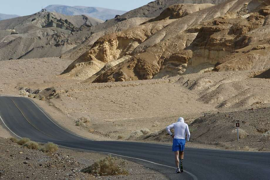 DEATH VALLEY NATIONAL PARK, CA JULY 15:  Double amputee Chris Moon of Great Britain runs in the AdventurCORPS Badwater 135 ultra-marathon race on July 15, 2013 in Death Valley National Park, California. Billed as the toughest footrace in the world, the 36th annual Badwater 135 starts at Badwater Basin in Death Valley, 280 feet below sea level, where athletes begin a 135-mile non-stop run over three mountain ranges in extreme mid-summer desert heat to finish at 8,350-foot near Mount Whitney for a total cumulative vertical ascent of 13,000 feet. July 10 marked the 100-year anniversary of the all-time hottest world record temperature of 134 degrees, set in Death Valley where the average high in July is 116. A total of 96 competitors from 22 nations are attempting the run which equals about five back-to-back marathons. Previous winners have completed all 135 miles in slightly less than 24 hours.  (Photo by David McNew/Getty Images) Photo: David McNew, Getty Images