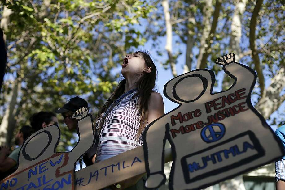 Kalisa Myers, 31, chants her slogans during a demonstration in reaction to the acquittal of neighborhood watch volunteer George Zimmerman on Wednesday, July 17, 2013, in Beverly Hills, Calif. (AP Photo/Jae C. Hong) Photo: Jae C. Hong, Associated Press