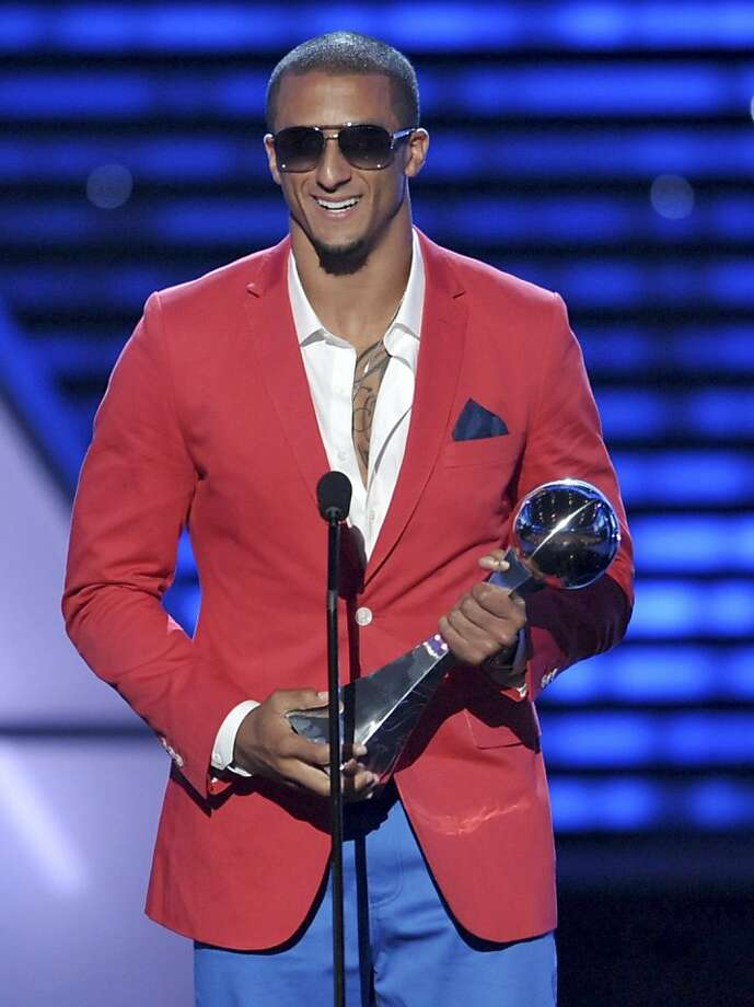 San Francisco 49ers' Colin Kaepernick accepts the award for best breakthrough athlete at the ESPY Awards. Photo: John Shearer, Associated Press