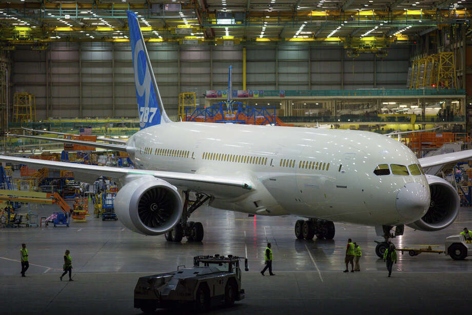 The first Boeing 787-9 widebody aircraft is towed out of the Everett 