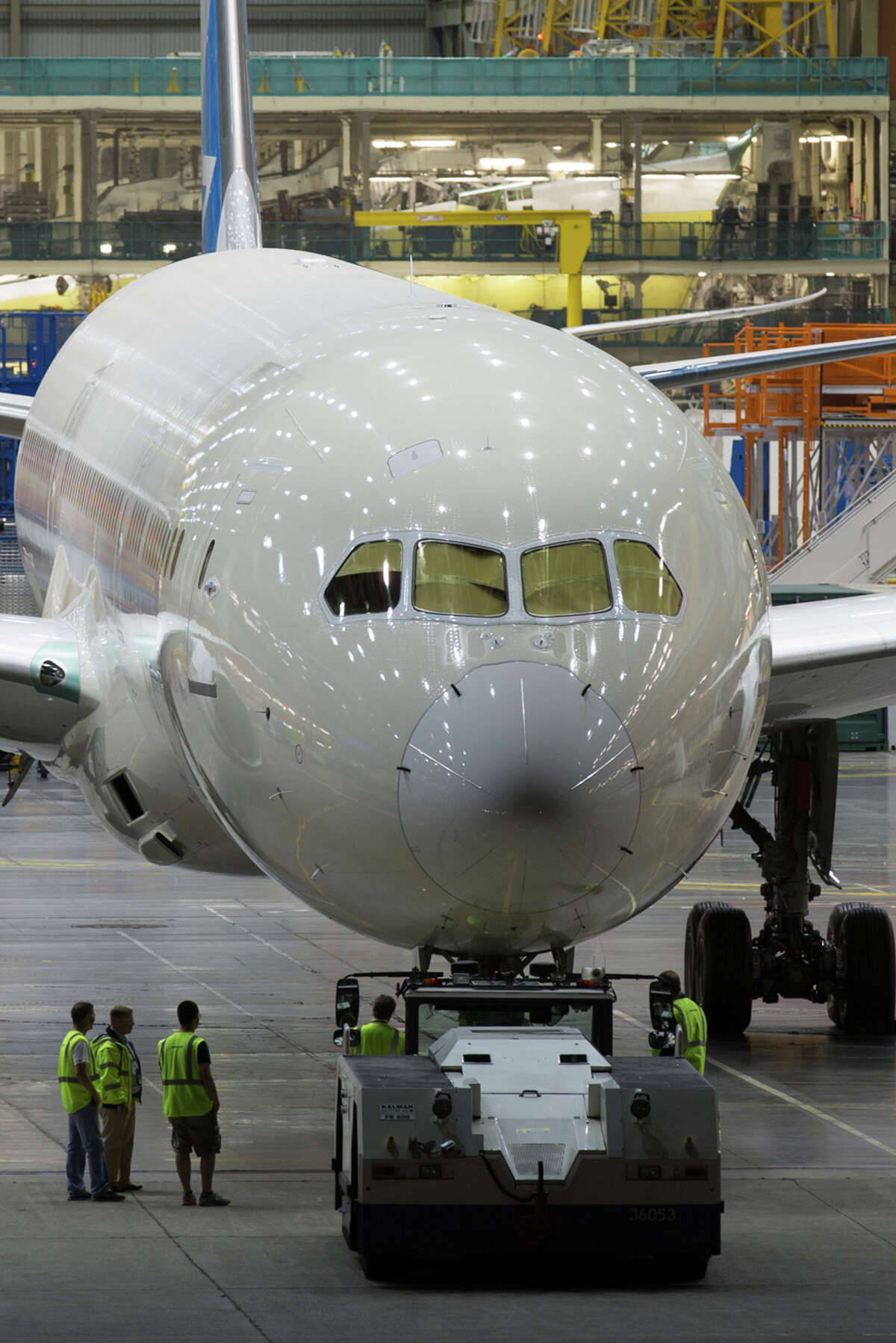 The first Boeing 787-9 widebody aircraft is towed out of the Everett factory on Wednesday, July 17, 2013. The passenger aircraft is a slightly larger version of the 787-8. It is about 20 feet longer and adds capacity for about 40 more passengers. The plane was moved from the plant in the middle of the night. Photos courtesy photographer Jeremy Dwyer-Lindgren.