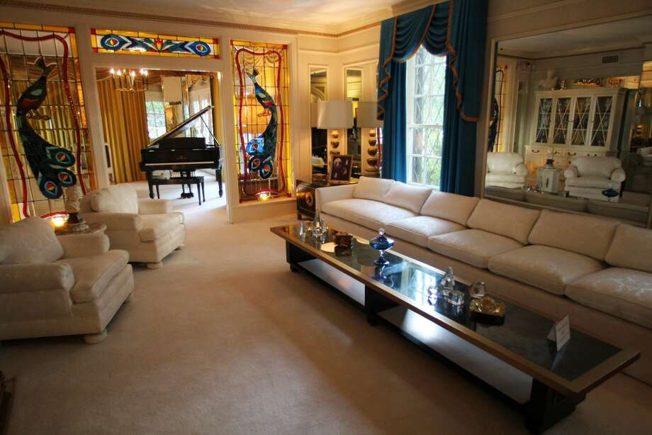 The living room at the Graceland mansion, the first room to greet guests when Elvis entertained.