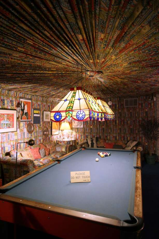 The pool room at the Graceland mansion offers some of the most hideous interior decorating in the history of the world, including a circular feature on the ceiling made of folded fabric.