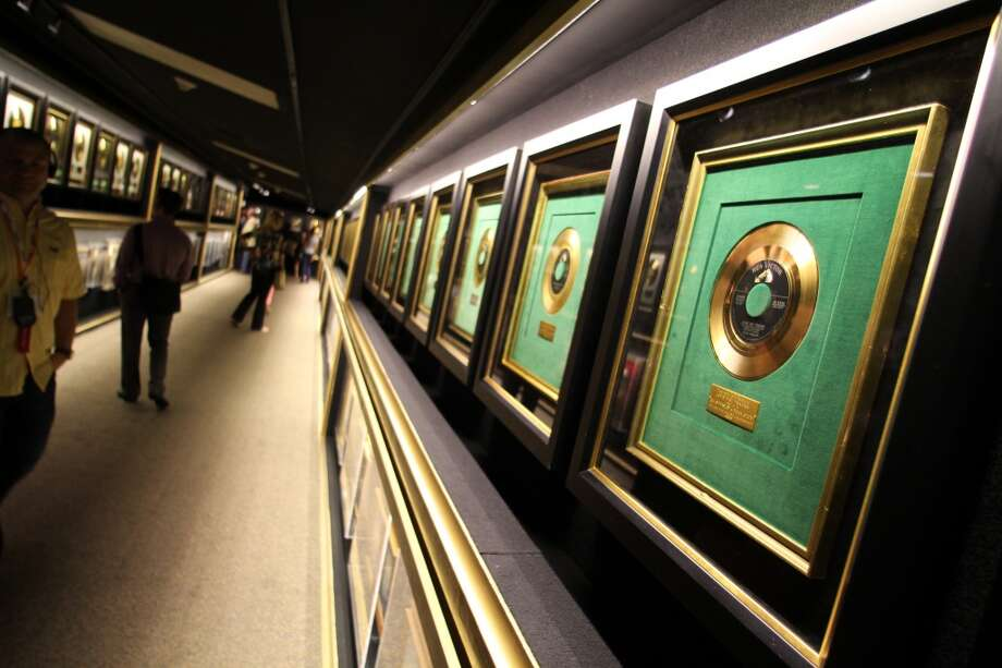One entire hallway is lined with Presley's gold and platinum records.