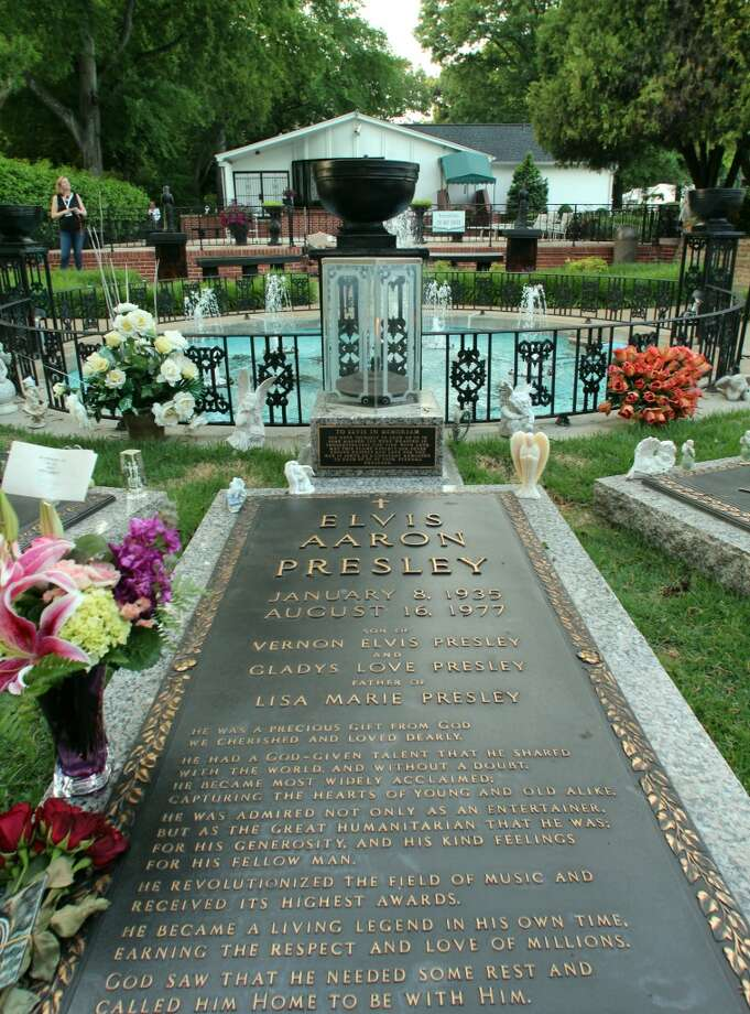 The gardens and eternal flame at Elvis' tomb.