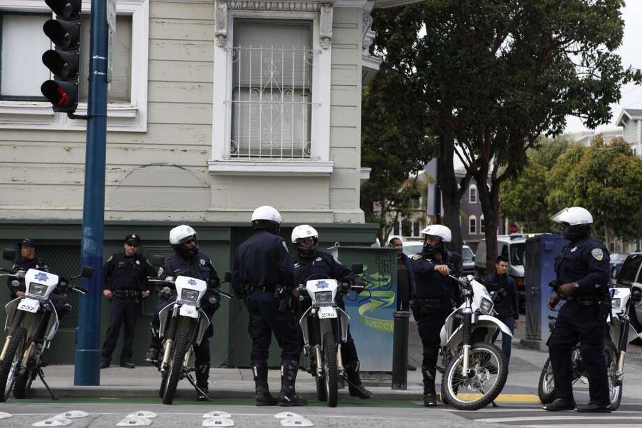 San FranciscoPolice officers stand guard during a protest against the San Francisco Police Department on the one year anniversary of the death of Kenneth Harding in San Francisco, Calif. on July 16, 2013.