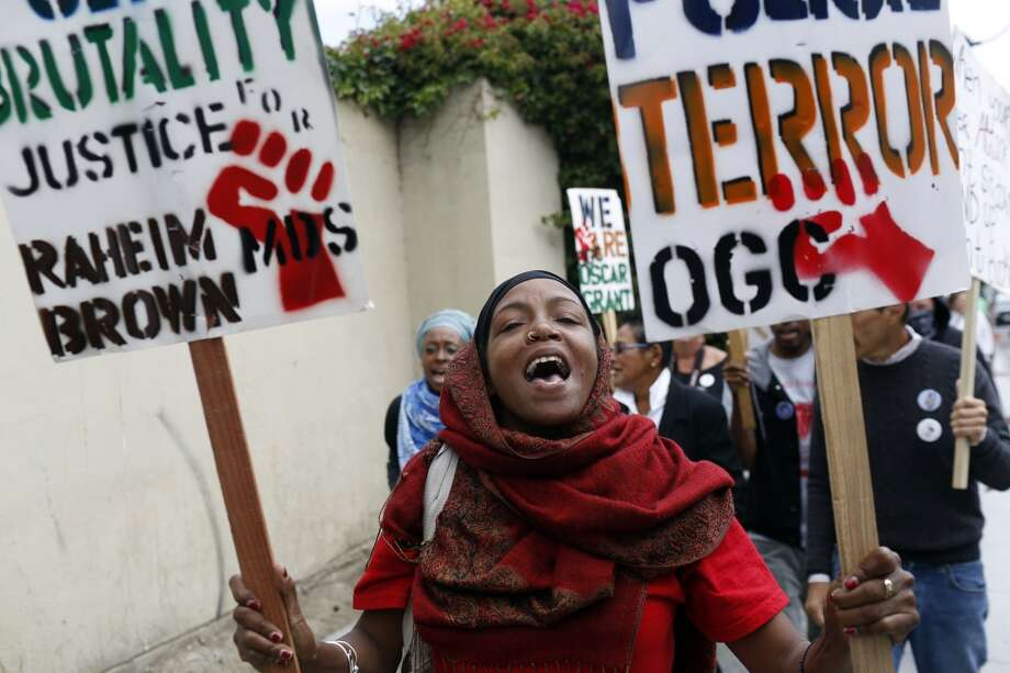 San Francisco  Tracey Bell-Borden chants during a protest against the San Francisco Police Department on the one year anniversary of the death of Kenneth Harding in San Francisco, Calif. on July 16, 2013.