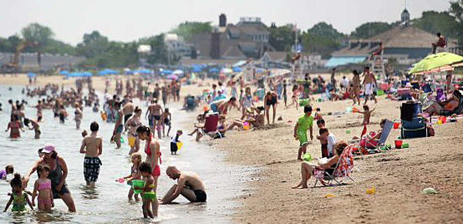 Beaches across southwestern should be jammed again today as people seek relief from an ongoing heat wave, which is not expected to break its sweltering grip on the region until late Saturday. Photo: File Photo / Westport News