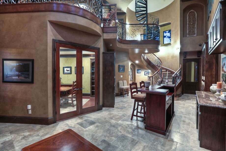 The home has two poker rooms, four game rooms, two media rooms and three wet bars.