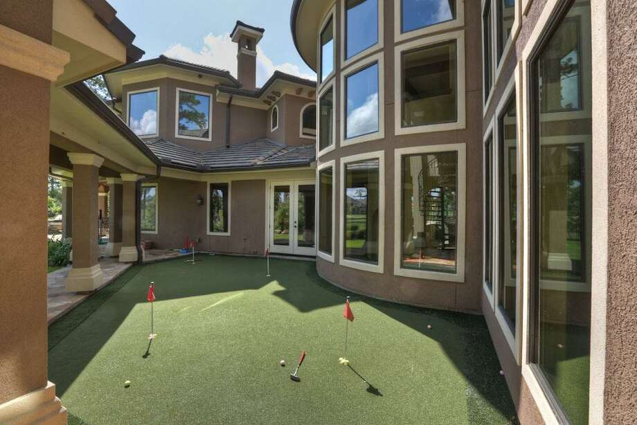 The home also has a putting green.