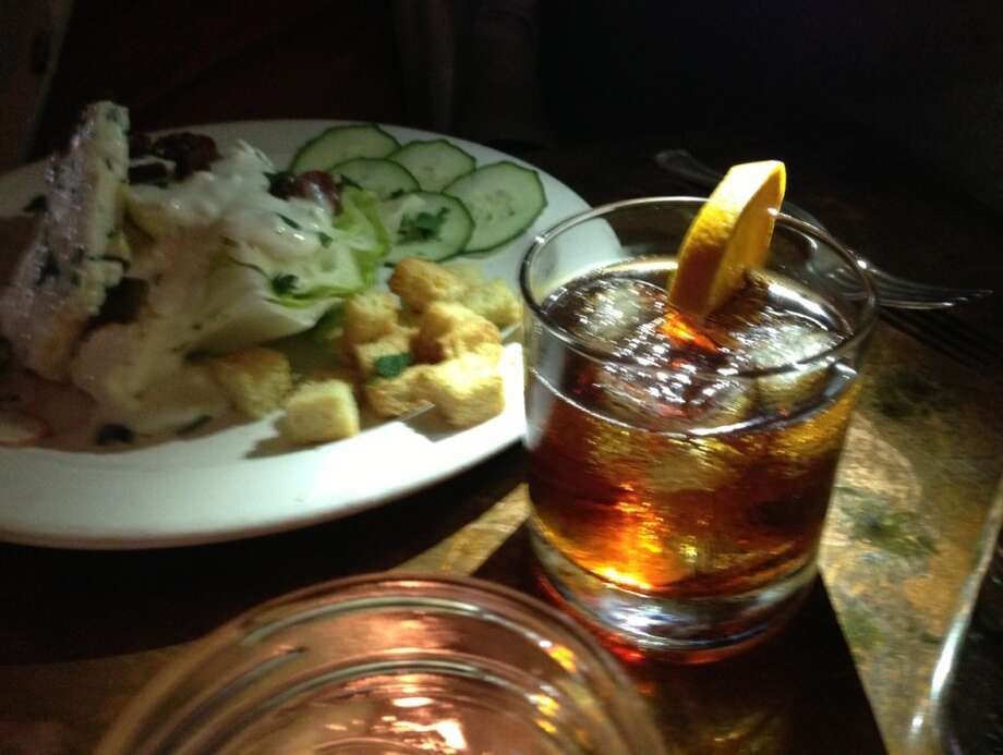 The Manhattan with the wedge salad in the background