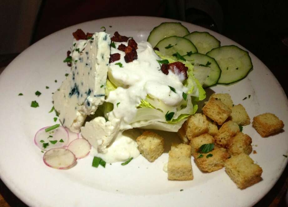 Wedge salad with a slice of blue cheese