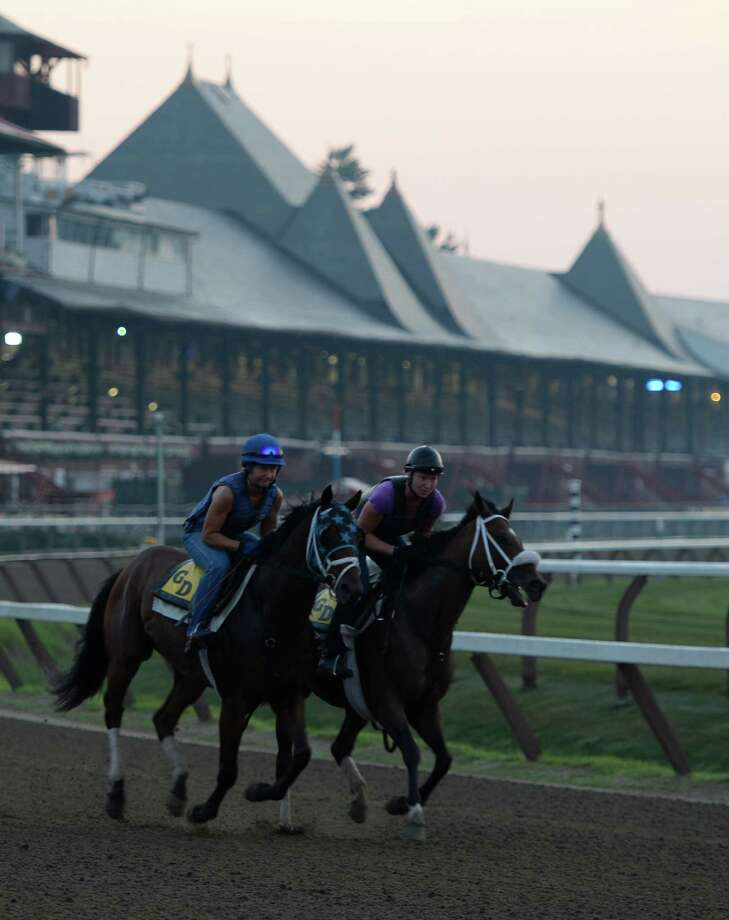 Horses trained by Glen DeSanto out for their morning exercise Thursday, July 18, 2013, at Saratoga Race Course in Saratoga Springs, N.Y. The 150th race meet begins Friday.  (Skip Dickstein/Times Union) Photo: SKIP DICKSTEIN / 10023138A