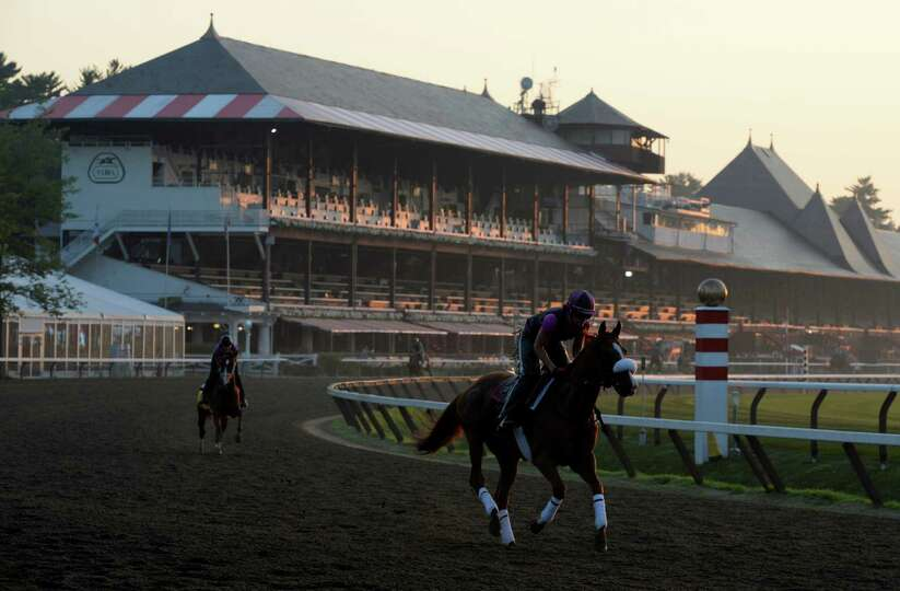 Horses out for morning exercise the morning of the day before opening day July 18, 2013, at the Sara