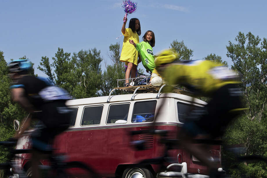 Overall leader's yellow jersey Britain's Christopher Froome rides past girls cheering during the 168 km sixteenth stage of the 100th edition of the Tour de France cycling race on July 16, 2013 between Vaison-la-Romaine and Gap, southeastern France. Photo: JOEL SAGET, AFP/Getty Images / 2013 AFP