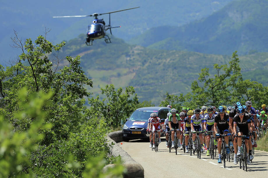 The peloton is chased by a television helicopter during stage sixteen of the 2013 Tour de France, a 168KM road stage from Vaison-la-Romaine to Gap, on July 16, 2013 in Gap, France. Photo: Doug Pensinger, Getty Images / 2013 Getty Images