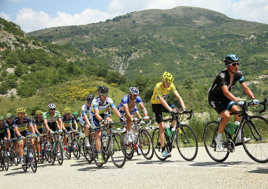 Christopher Froome of Great Britain and Team Sky Procycling keeps the race leader's yellow jersey after stage sixteen of the 2013 Tour de France, a 168KM road stage from Vaison-la-Romaine to Gap on July 16, 2013 in Gap, France. Photo: John Berry, Getty Images / 2013 John Berry
