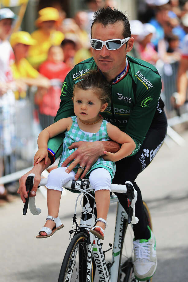 Thomas Voeckler of France and Team Europcar rides with his daughter Lila before stage eighteen of the 2013 Tour de France, a 172.5KM road stage from Gap to l'Alpe d'Huez, on July 18, 2013 in Gap, France. Photo: Doug Pensinger, Getty Images / 2013 Getty Images