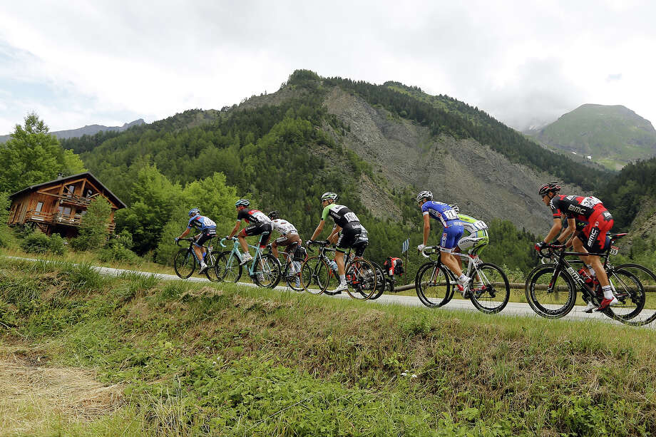 (From L) USA's Thomas Danielson, Germany's Jens Voigt, France's Christophe Riblon, Netherland's Lars Boom, France's Arnold Jeannesson, Italy's Moreno Moser and USA's Tejay Van Garderen rides in the breakaway during the 172.5 km eighteenth stage of the 100th edition of the Tour de France cycling race on July 18, 2013 between Gap and Alpe-d'Huez, French Alps. Photo: PASCAL GUYOT, AFP/Getty Images / 2013 AFP