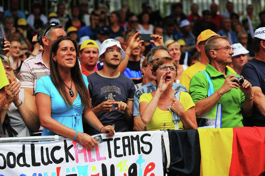 Cycling fans come out to support the riders before the start of stage eighteen of the 2013 Tour de France, a 172.5KM road stage from Gap to l'Alpe d'Huez, on July 18, 2013 in Gap, France. Photo: Doug Pensinger, Getty Images / 2013 Getty Images