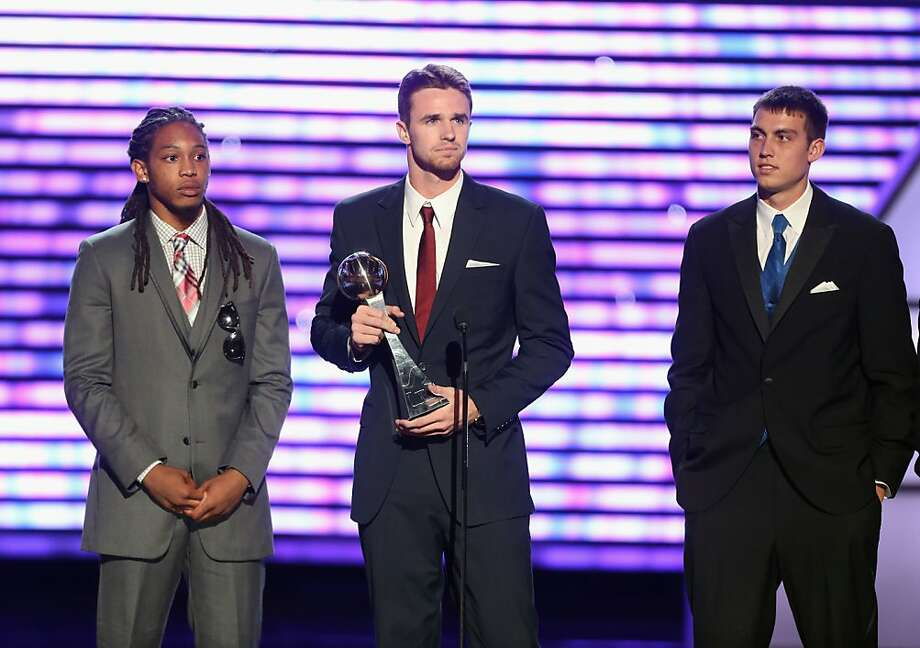 Florida Gulf Coast men's basketball team players Sherwood Brown, Eddie Murray and Chase Fieler, winners of Best Upset, speak onstage at The 2013 ESPY Awards. Photo: Frederick M. Brown