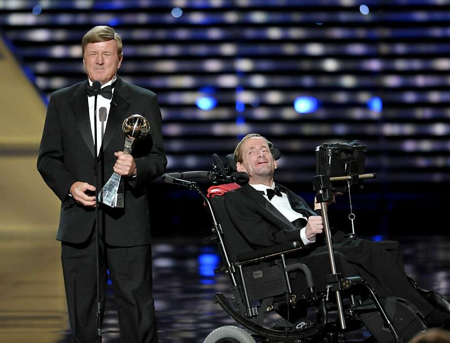 Dick Hoyt, left, and Rick Hoyt,  accept the Jimmy V Perseverance Award at the ESPY Awards on Wednesday, July 17, 2013, at the Nokia Theater in Los Angeles. Photo: John Shearer, Associated Press