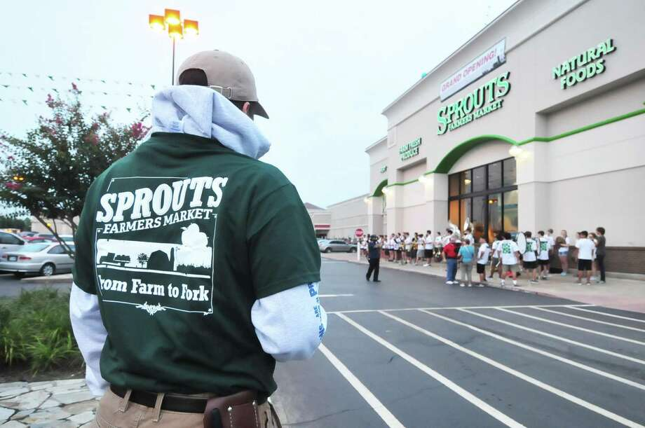 Joe Moreno (produce clerk) takes a moment to reflect as customers line up before a 7 a.m.grand-opening celebration of a new Sprouts Market store on Texas  in Cy-Fair July 17. Photo: © Tony Bullard 2013, Tony Bullard / © Tony Bullard & the Houston Chronicle