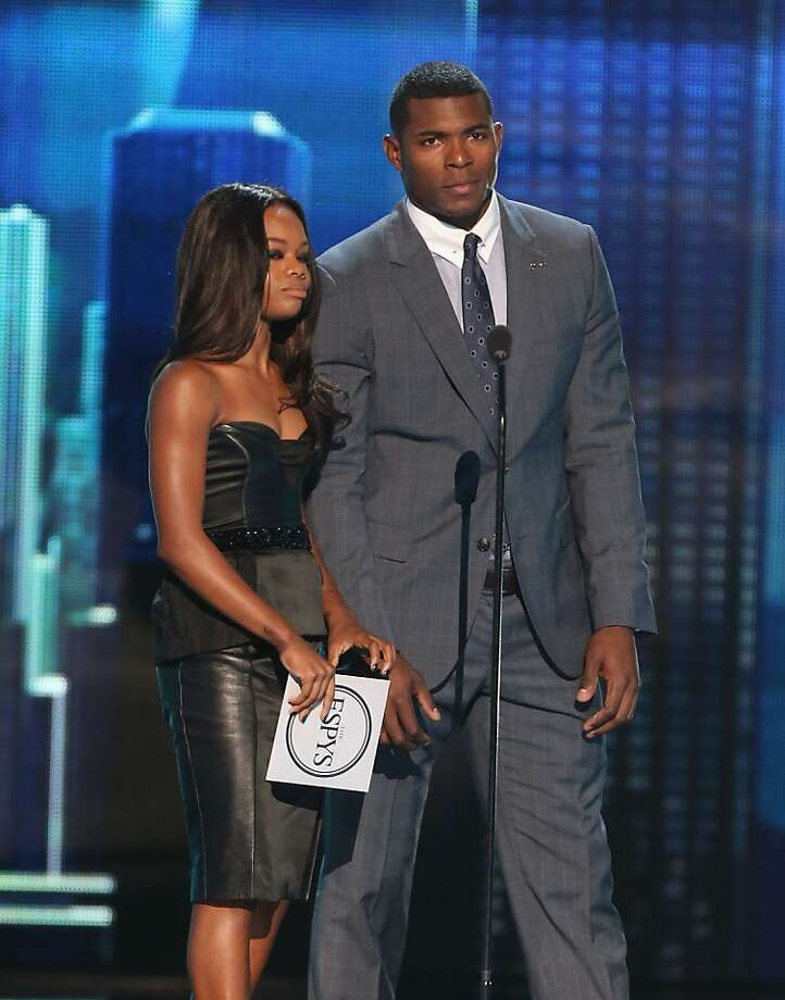 Olympian Gabrielle Douglas and MLB player Yasiel Puig onstage at The 2013 ESPY Awards. Photo: Frederick M. Brown, Getty Images For ESPY