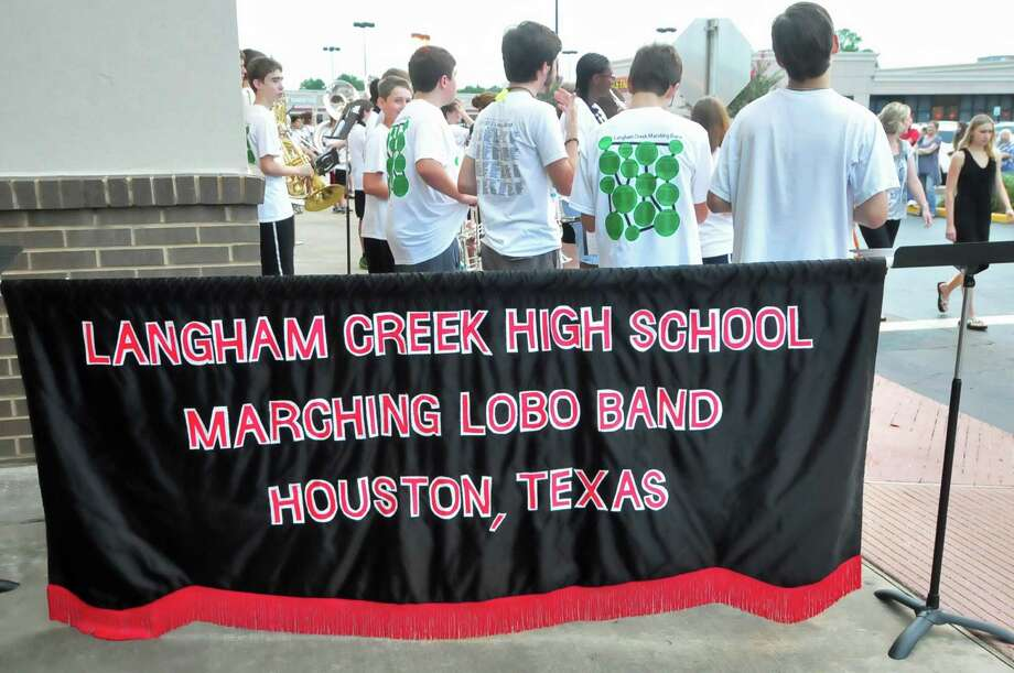 The Langham Creek High School marching band performed as Sprouts Market held a grand-opening celebration for a new store on Texas 6 in Cy-Fair on July 17 Photo: © Tony Bullard 2013, Tony Bullard / © Tony Bullard & the Houston Chronicle