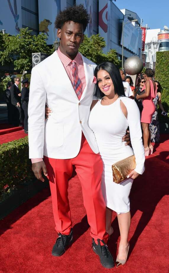 49ers defensive star Aldon Smith and his guest on the red carpet.