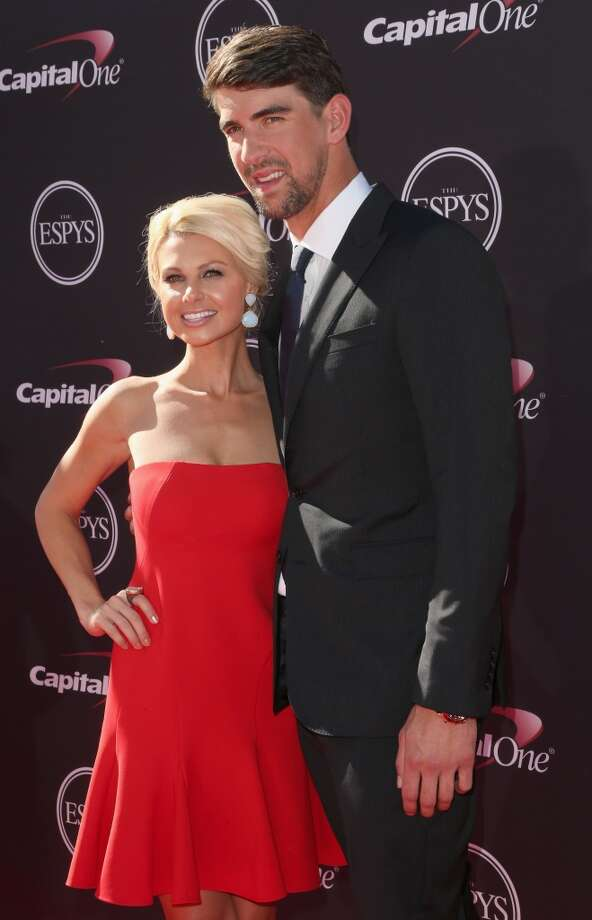 Olympic swimmer Michael Phelps and his guest on the red carpet.