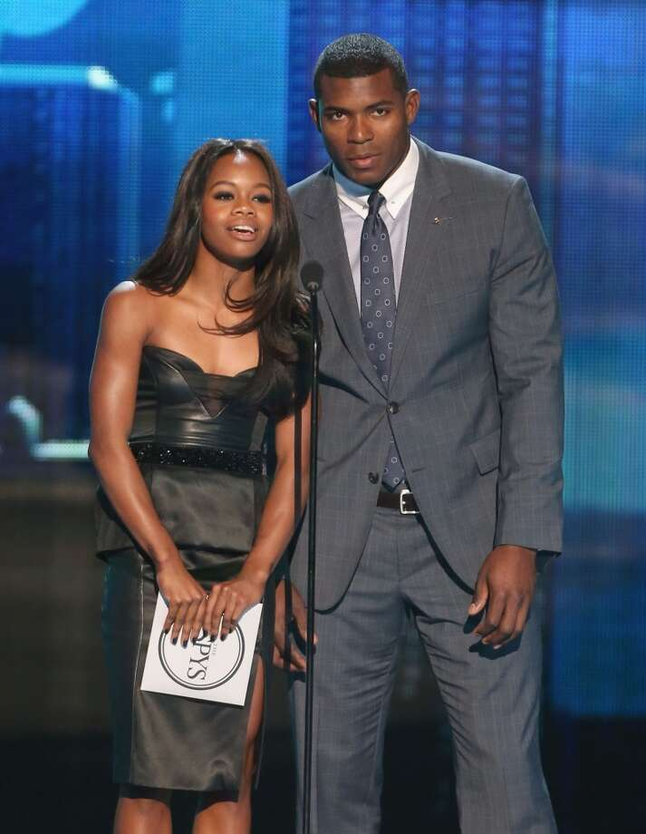 Olympic gymnast Gabby Douglas and Dodgers rookie sensation Yasiel Puig present an award.