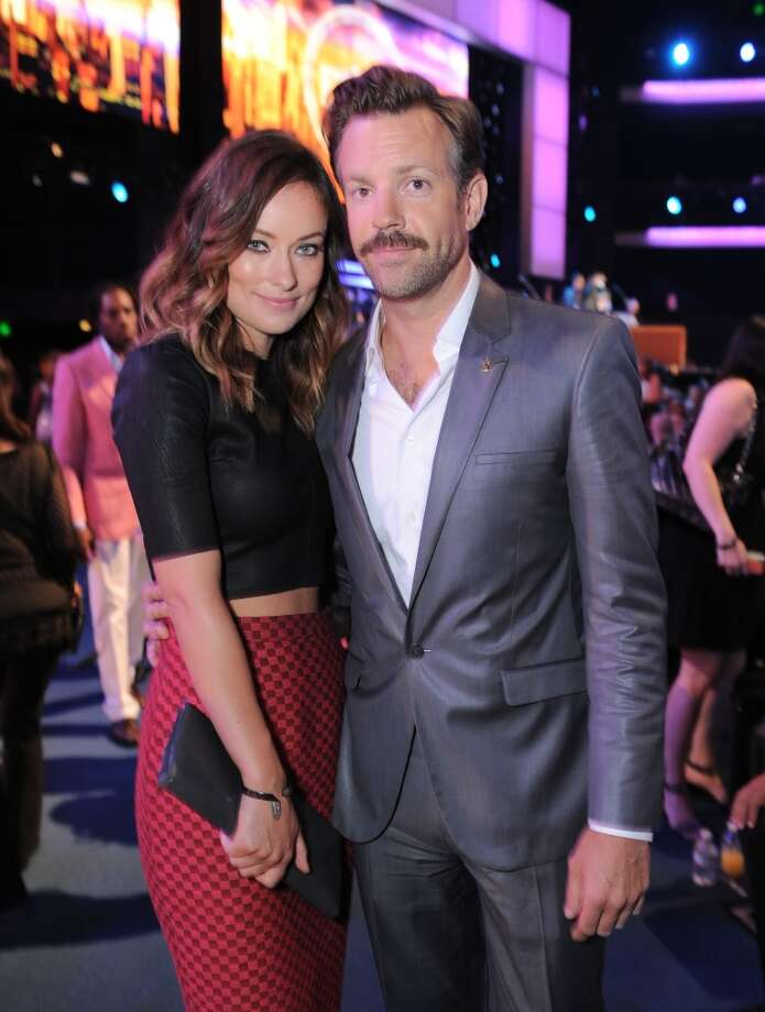Actors Olivia Wilde, left, and Jason Sudeikis pose in the audience.