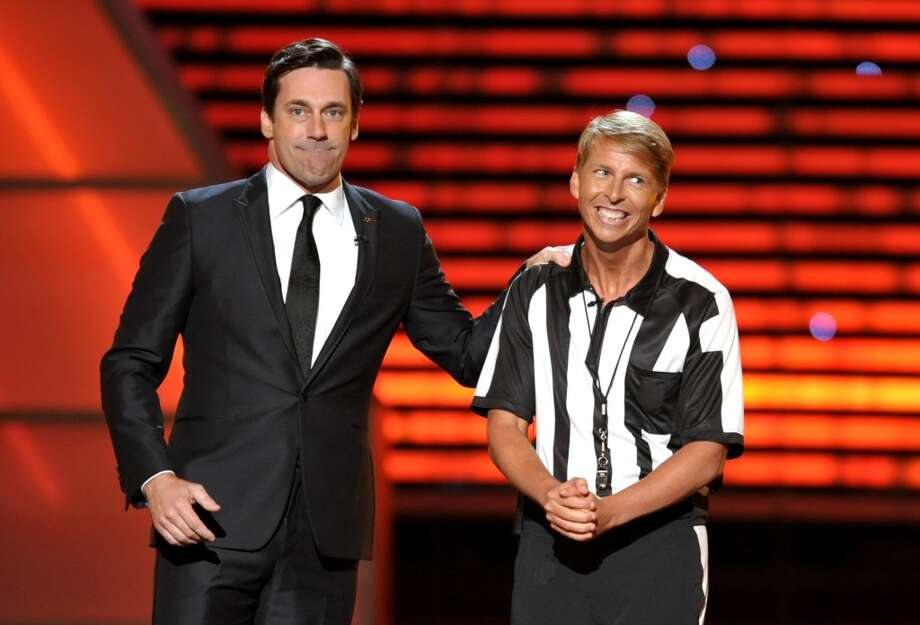 Actors Jon Hamm, left, and Jack McBrayer do a skit.