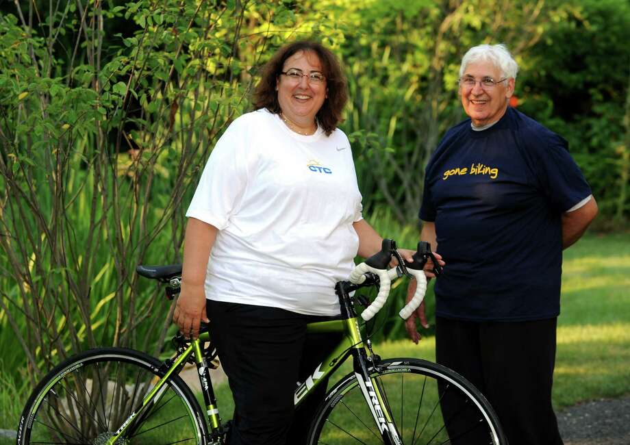 Marylee Ritchey and her father Joe Gerardi , pictured at the Connecticut Challenge Center for Survivorship in Southport, Conn. on Wednesday July 17, 2013. Ritchey and Gerardi will participate in the upcoming CT Challenge ride, which this year will be held on July 26th & 27th. The Center for Survivorship is funded at least in part by proceeds from the ride. Photo: Cathy Zuraw / Connecticut Post