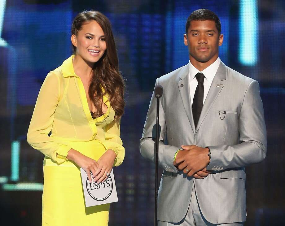 Seahawks quarterback Russell Wilson and model Chrissy Teigen present award for best game at The 2013 ESPY Awards. Photo: Frederick M. Brown, Getty Images For ESPY