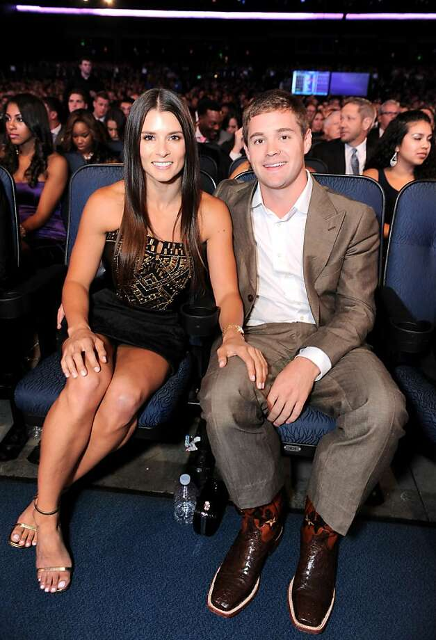 Danica Patrick, left, and Ricky Stenhouse Jr. pose in the audience at the ESPY Awards. Photo: Jordan Strauss, Associated Press