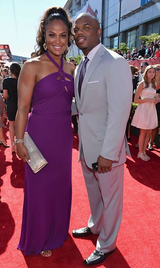 TV personality Laila Ali (L) and husband former NFL player Curtis Conway attend The 2013 ESPY Awards. Photo: Alberto E. Rodriguez, Getty Images For ESPY
