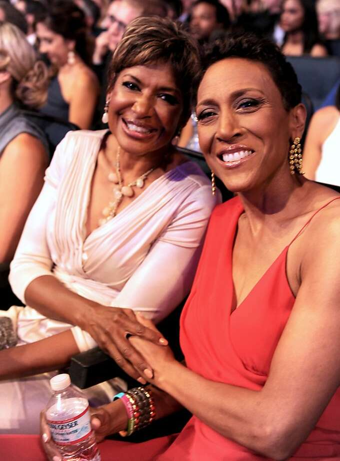 Sally-Ann Roberts, left, and Robin Roberts pose in the audience at the ESPY Awards. Photo: Jordan Strauss, Associated Press