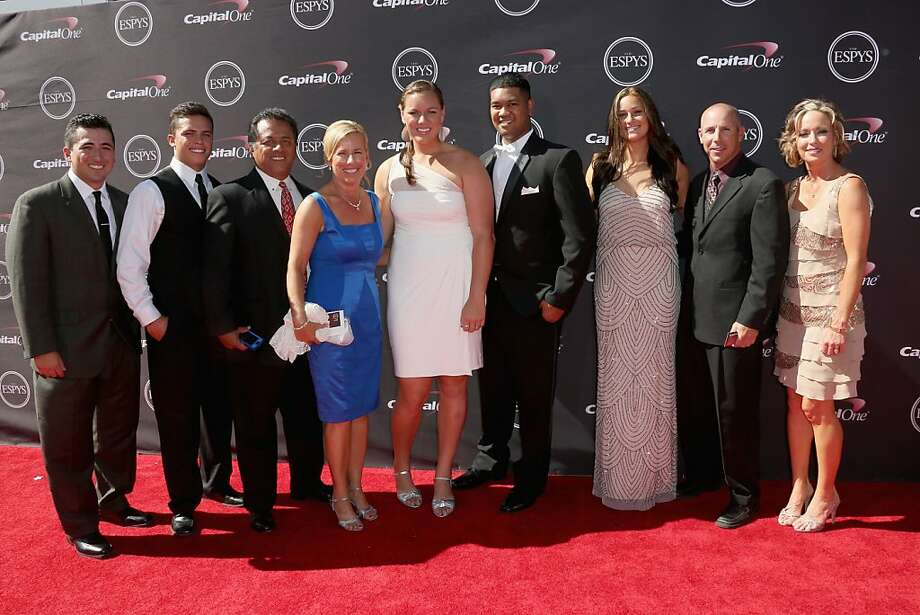 Coach Patty Gasso (4th L), players Keilani Rickett (C) and Lauren Chamberlain (3rd R) of the national champion Oklahoma Sooners softball team, and guests attend The 2013 ESPY Awards. Photo: Frederick M. Brown, Getty Images
