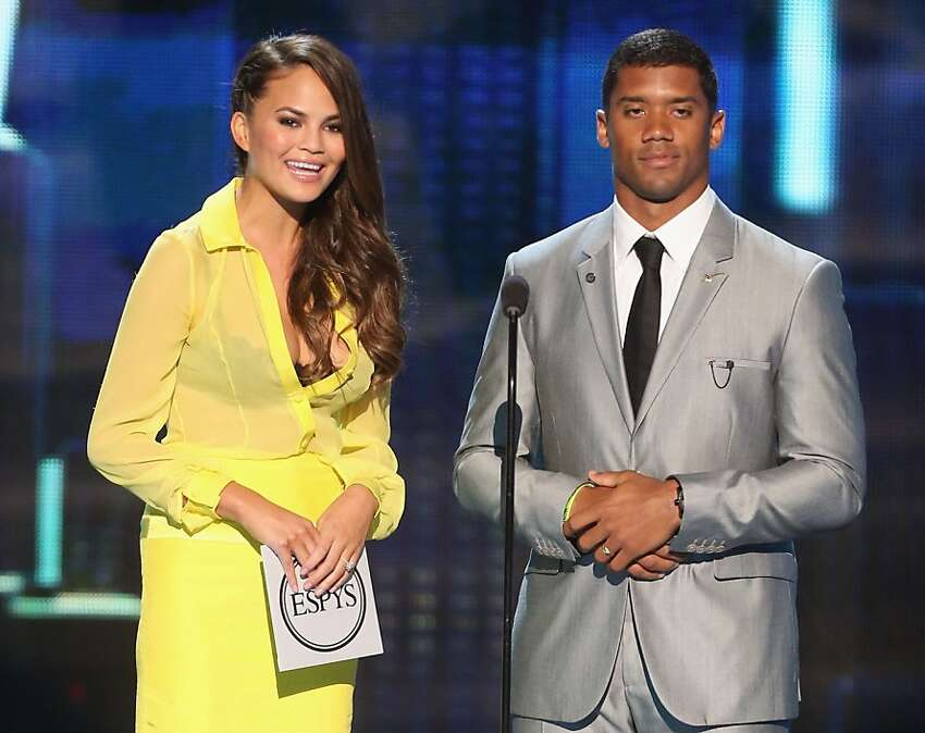 Seahawks quarterback Russell Wilson and model Chrissy Teigen present award for best game at The 2013 ESPY Awards.