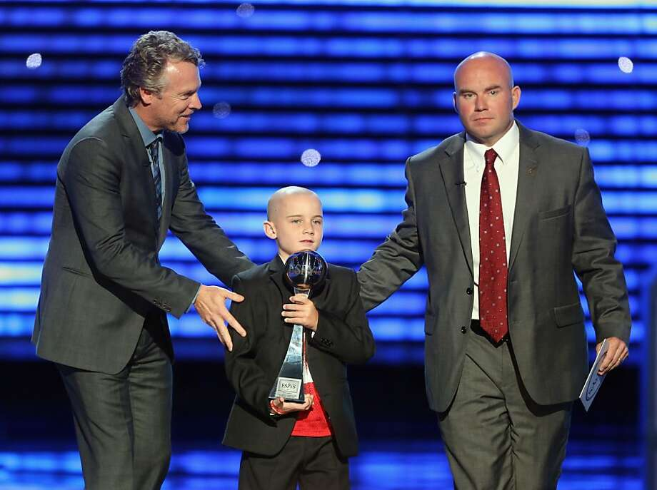 Actor Tate Donovan, Best Moment award winner Jack Hoffman and father Andy Hoffman speak onstage at The 2013 ESPY Awards. Photo: Frederick M. Brown, Getty Images For ESPY