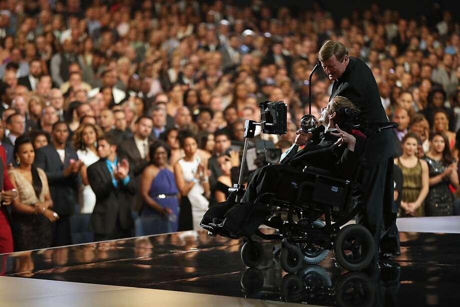 Jimmy V award recipients Dick Hoyt and son Rick Hoyt accepting an award onstage at The 2013 ESPY Awards. Photo: Christopher Polk
